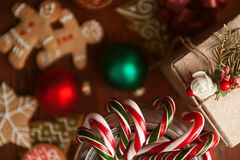 Christmas still life. homemade ginger biscuits, cane candy, on a wooden background. Royalty Free Stock Photos