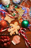 Christmas still life. homemade ginger biscuits, cane candy, on a wooden background. Stock Photography