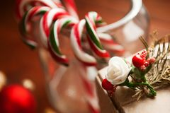 Christmas still life. homemade ginger biscuits, cane candy, on a wooden background. Stock Photo