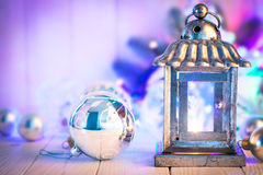 Christmas still life with lamp garland and balls Stock Image