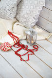 Christmas still life with lantern and red beads on wooden backgr Stock Photo