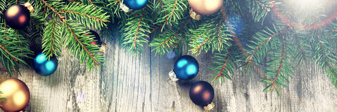 Christmas still-life with multicolor baubles and fir branches Stock Images