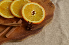 Christmas still life. With oranges and cinnamon Stock Image