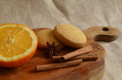 Christmas still life. With oranges, cinnamon and cookies Stock Image