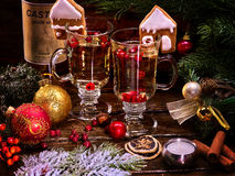 Christmas still life with pair latte mug cocktail on ribbon. Royalty Free Stock Images