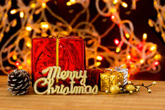 Christmas still life with parcel and lights Stock Photos