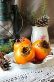 Christmas still life with persimmons Stock Image