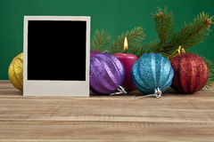 Christmas still life with a photo Royalty Free Stock Photo