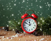 Christmas still life with red alarm clock and pine branches. Stock Images