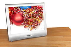 Christmas still life with red ball on screen of TV Stock Photography