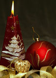 Christmas  still life - red burning candle with ev Royalty Free Stock Photography