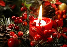 Christmas still life. Red candle and christmas decorations stock images