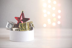 Christmas still life with red star and gifts on background lights Royalty Free Stock Photo