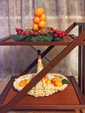 Christmas still life of a small wooden table on wheels royalty free stock image