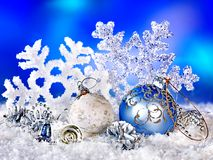 Christmas still life with snowflake and ball. Holiday decoration Royalty Free Stock Image