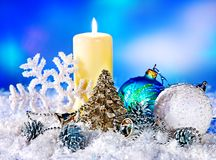 Christmas still life with snowflake and candle. Holiday decoration Royalty Free Stock Image