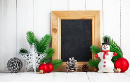 Christmas still life with snowman and firtree on wooden board Royalty Free Stock Photography