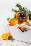 Christmas still life with tangerines Stock Photography