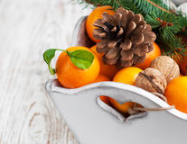 Christmas still life with tangerines Royalty Free Stock Photography