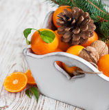 Christmas still life with tangerines Royalty Free Stock Images