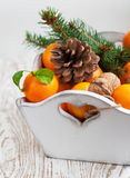 Christmas still life with tangerines Royalty Free Stock Image