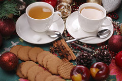 Christmas still life with tea and biscuits on the. Christmas still life with tea and pepper biscuits on the table Royalty Free Stock Image