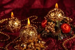 Christmas still life with spherical candles on Burgundy background stock photography