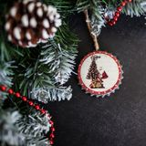 Christmas still life with toy angel and Christmas decorations. lsoft focus, blurred background. stock photo
