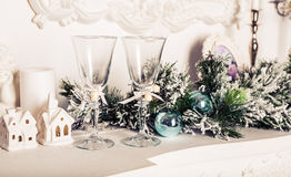 Christmas still life - Two glasses of champagne with Xmas decorations Stock Photos