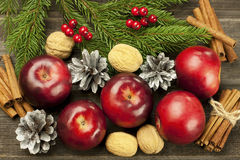 Christmas still life with walnuts and apples Stock Images