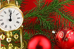 Christmas still life with  watch and red bolls Stock Photography