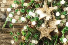 Christmas still life wooden ornaments and lights Stock Image