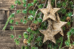 Christmas still life wooden ornaments and pine tree branches Royalty Free Stock Image