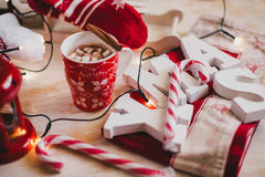 Christmas still life with XMAS letters, cup of cocoa with marshmallows and cinnamon Stock Photos