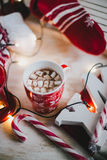 Christmas still life with XMAS letters, cup of cocoa with marshmallows and cinnamon Royalty Free Stock Photos