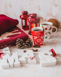 Christmas still life with XMAS letters, tea and present Royalty Free Stock Photo