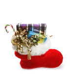 Christmas stocking. A christmas stocking overflowing with gifts royalty free stock photos