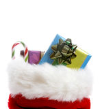 Christmas stocking. A christmas stocking overflowing with gifts stock photography