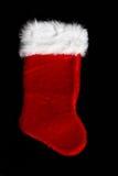 Christmas Stocking. Large Christmas stocking on black background Stock Photos