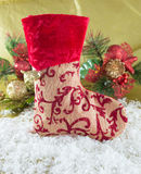 Christmas stocking. Red Christmas stocking and decorations on the snow Royalty Free Stock Image