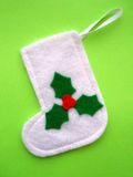 Christmas Stocking. Decorated with a green holly symbol stock photos