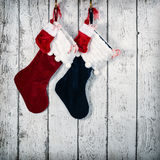 Christmas stocking against rustic wood Royalty Free Stock Photo
