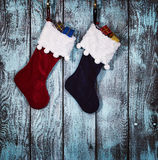 Christmas stocking against rustic wood Royalty Free Stock Image