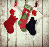 Christmas stocking against rustic wood Stock Image