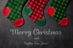Christmas stocking on a blackboard background, xmas card Stock Images