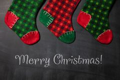 Christmas stocking on a blackboard background, xmas card Royalty Free Stock Photos
