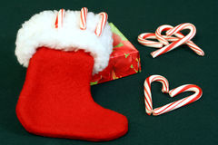 Christmas stocking with candy canes and gift. Stock Photo