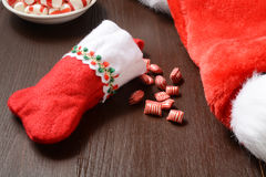 Christmas stocking with candy Stock Photography