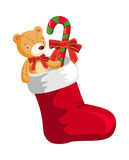 Christmas stocking. Cartoon Christmas stocking with gifts Royalty Free Stock Images