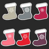 Christmas stocking in color with snowflakes. Stock Image